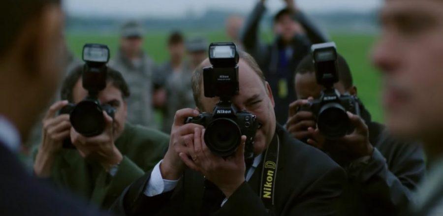 Nikon photo camera in War Machine (2017)
