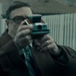 Polaroid camera John Goodman in Captive State (2019)